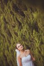 Bride portrait over green trees outdoor beautiful closeup Stock Image