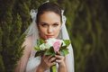 Bride portrait over green trees outdoor beautiful closeup Royalty Free Stock Images