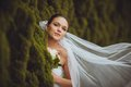 Bride portrait over green trees outdoor beautiful closeup Royalty Free Stock Image
