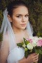 Bride portrait over green trees outdoor beautiful closeup vertical Royalty Free Stock Photos