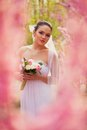 Bride portrait over pink cherry trees outdoor beautiful Royalty Free Stock Photos