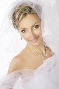 Bride portrait wedding jewelry necklace earrings makeup hairstyle and smile in white veil Royalty Free Stock Photos