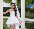 Bride posing looking at camera smiling Royalty Free Stock Photos