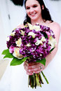 Bride with Purple and White Bouquet Royalty Free Stock Photo