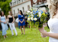 Bride ready to throw away her wedding bouquet Stock Images