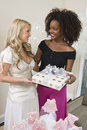 Bride Receiving Gift From Her Friend Royalty Free Stock Photography