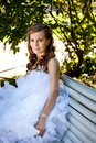 Bride relaxing in the park beautiful Royalty Free Stock Photo