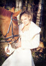 Bride ride near sorrel  horse in forest Royalty Free Stock Photo