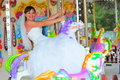 Bride riding the carousel Royalty Free Stock Photo