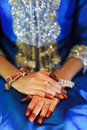 Bride s hand with diamond ring wearing a blue wedding dress and Royalty Free Stock Photography