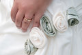 Bride s hand wearing wedding ring and roses Stock Photo