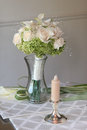 Bride s wedding bouquet waiting vase Royalty Free Stock Images