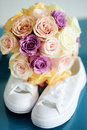 Bride`s white sneackers and beautiful bridal bouquet Royalty Free Stock Photo