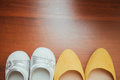 Bride shoes and shoes child on wood Royalty Free Stock Images
