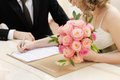 Bride signing marriage license Royalty Free Stock Image
