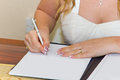 Bride signing marriage registration form Stock Photos