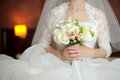 Bride Sitting with Bouquet Stock Image