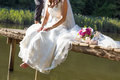 Bride a sitting at nature Royalty Free Stock Image
