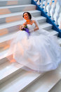 Bride sitting on the stairs beautiful young Stock Photos