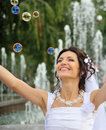 The bride and soap bubbles Royalty Free Stock Photography