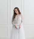 Bride standing with wedding accessories Royalty Free Stock Photo