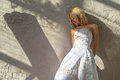 Bride stands about the walls plastered Royalty Free Stock Images