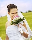 Bride summer outdoor holding flower wedding Stock Photos