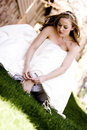Bride taking off her shoes Royalty Free Stock Images