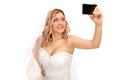 Bride taking a selfie cheerful with her cell phone on white background Stock Photography