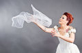 Bride throwing her veil Royalty Free Stock Image