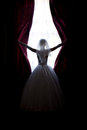 Bride throws open curtains on window