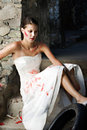 Bride trashing her dress Royalty Free Stock Photography