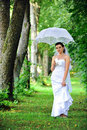 Bride with umbrella Royalty Free Stock Images