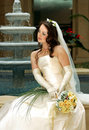 Bride with veil holding bouquet Royalty Free Stock Images