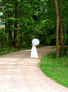 Bride on back road Royalty Free Stock Photo