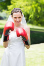 Bride wearing boxing gloves in garden portrait of young Royalty Free Stock Photography