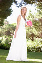 Bride Wearing Dress Holding Bouqet At Wedding Stock Photos