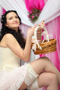 Bride wearing short dress and holds basket Stock Photos