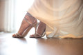 Bride wearing wedding shoes. Close-up details of brides feet wearing shoes Royalty Free Stock Photo