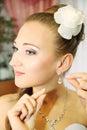 Bride wears earrings