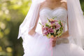 Bride with wedding bouquet violet rose ribbon Stock Image