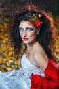 Bride in wedding dress attractive a with bright makeup red shawl Royalty Free Stock Photography