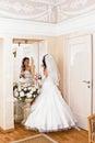 Bride in wedding dress looks in the mirror Stock Image