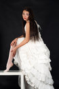Bride in a wedding dress straightens stockings Royalty Free Stock Photo