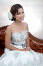 Bride with wedding dress young looking Royalty Free Stock Photography