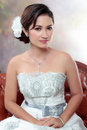 Bride with wedding dress young looking Royalty Free Stock Image