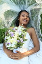 Bride on wedding lying on grass Royalty Free Stock Photo