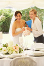 Bride with wedding planner in marquee laughing Royalty Free Stock Photography