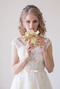 The bride at a wedding in room eating white chocolate