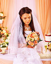 Bride at wedding table sad and cake Stock Photo